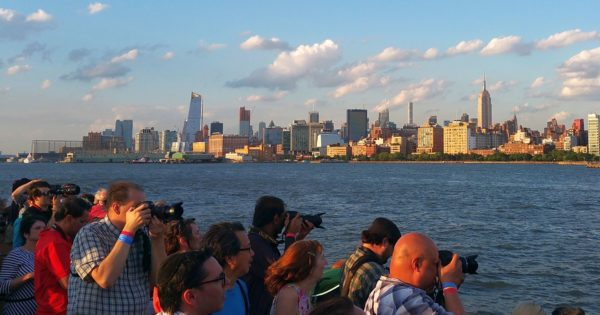 """""""Up-close perspective of Manhattan skyline, Statue of Liberty and Brooklyn Bridge with sea breezes."""""""